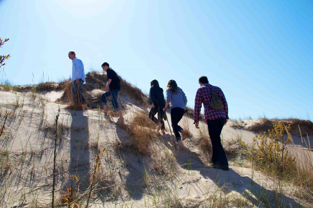 Hiking the dunes. A good time for the whole family.